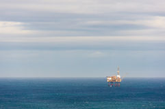 Oil rig drilling platform on sea Stock Images
