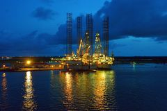 Oil rig at dusk Stock Photos