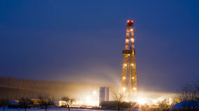 Oil rig in the field. Oil well in the field, blue sky Royalty Free Stock Images