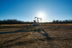 Oil rig in the field Stock Images
