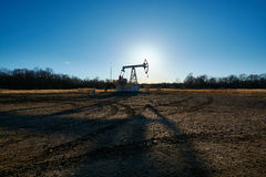 Oil rig in the field Royalty Free Stock Images