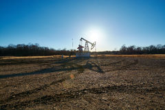 Oil rig in the field Royalty Free Stock Image
