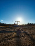 Oil rig in the field Royalty Free Stock Photo