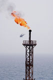 Oil Rig Flame. With a helicopter Royalty Free Stock Photos