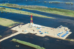 Oil rig in flooded area near great river, top view Stock Image