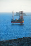 Oil Rig just off shore Stock Image
