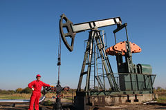 Oil Rig and Laborer Royalty Free Stock Images