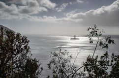 An oil rig near the shore at Las teresitas stock images