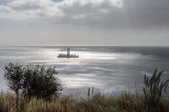 An oil rig near the shore at Las teresitas stock image