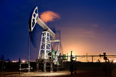 Oil Rig at night. Stock Photos