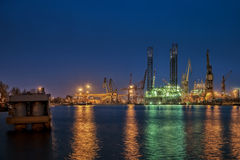 Oil Rig at night. Oil drilling platform for repairs at shipyard in Gdansk, Poland Royalty Free Stock Images