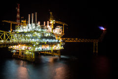 Oil rig at night with twilight background. The large offshore oil rig at night with twilight background Stock Photography