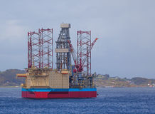 Oil rig in north sea. Oil rig at sunset in the north sea royalty free stock photos