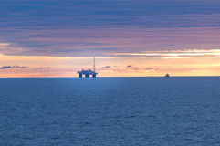 Oil rig in north sea. Oil rig at sunset in the north sea stock photos