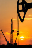 Oil rig over orange sky Royalty Free Stock Photography