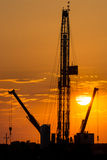 Oil rig over orange sky Royalty Free Stock Photo
