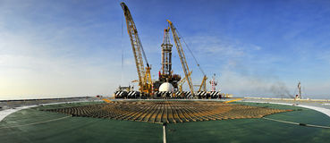 Oil rig panoramic. From helicopter pad Royalty Free Stock Photo