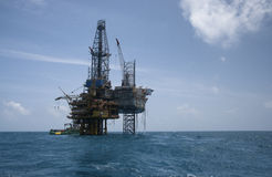 Oil rig platform on calm blue sea. Oil platform at south china sea during afternoon with cloudy sky stock images