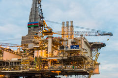 Oil rig platform. In the calm sea Stock Photos