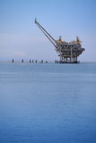Oil Rig Platform at Sea. Oil rig platform near seashore on a calm day royalty free stock images