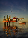 Oil rig platform during sunset Stock Photo