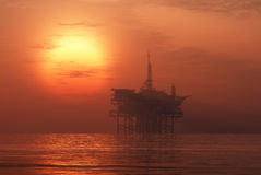 Oil Rig. Oil production into the sea in the fog royalty free illustration
