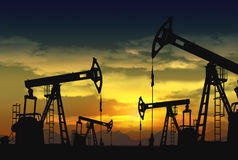 Oil rig pump jack. Oil pump jack in operation Royalty Free Stock Photo