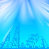 Oil rig and pump over blue luminous ray Stock Photography