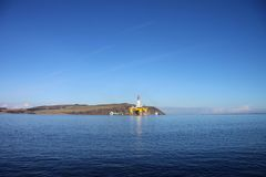 Oil rig in Scottish estuary Stock Photos