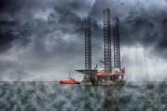 Oil Rig. At sea on a dark cloudy dramatic sky Stock Photos