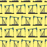 Oil rig seamless pattern. Oil pump pumps oil  background. Royalty Free Stock Photo