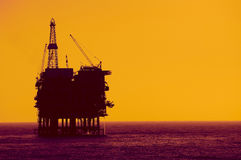 Oil rig silhouete royalty free stock photos
