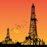 Oil rig silhouettes. And orange sky,  illustration Royalty Free Stock Photography