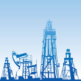 Oil rig silhouettes. And blue sky, vector illustration Royalty Free Stock Image