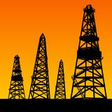 Oil rig silhouettes and orange sky. Vector illustration, eps10, contains transparencies, gradients and effects Royalty Free Stock Photo