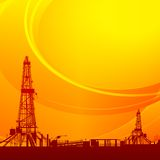 Oil rig silhouettes and orange sky Royalty Free Stock Images