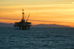 Oil Rig Sunset. An offshore oil rig during sunset off southern California coast