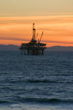 Oil Rig Sunset. An offshore oil rig during sunset off southern California coast Stock Photos