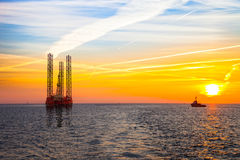 Oil rig. At sunset background stock photos