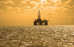 Oil rig during sunset in Caspi. Oil rig during sunset in Baku, Azerbaijan in Caspian Sea