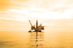 Oil Rig during. Sunset hours Royalty Free Stock Image