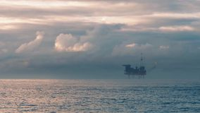 Oil Rig At Sunset. Oil platform rig out at sea in beautiful evening light stock video