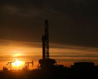 Oil rig in the sunset Royalty Free Stock Image