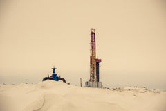 Oil rig and wellhead in the oilfiled Royalty Free Stock Photo