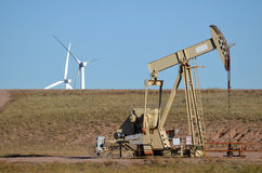 Oil Rig with Wind Turbines. Oil Rig Pump Jack with Wind Turbines in background royalty free stock photography