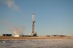 Oil rig in the winter. An oil rig on a cold but sunny day in North Dakota.i Royalty Free Stock Photography