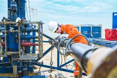 Oil rig worker inspect and setting up top side tools for safety first to perforation oil and gas production well. Offshore oil and gas industry, oil rig worker royalty free stock photos