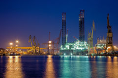 Oil rig in the yards. Night view of yards offshore drilling in the background Stock Photos