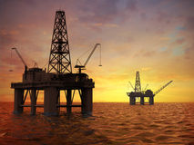 Oil rigs. Oil exploration rigs at sunset Stock Photography