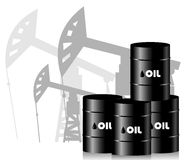Oil rigs and barrels of oil. Royalty Free Stock Photo